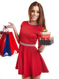 Woman with Christmas gifts. Stock Photography