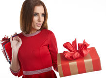 Woman with Christmas gifts. Royalty Free Stock Image
