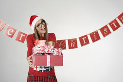 Woman at Christmas. Woman happy to give some Christmas presents royalty free stock photos