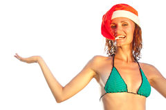 Woman in christmas hat Stock Image