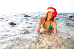 Woman in christmas hat Stock Photos