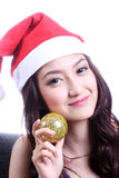 Woman with a christmas hat and carrying rubber ball Royalty Free Stock Photography