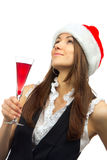 Woman in christmas hat drinking cocktail Stock Image