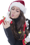Woman with christmas hat with funny dolls Royalty Free Stock Images