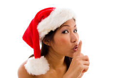 Woman with christmas hat and gesturing Royalty Free Stock Images