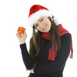 Woman in Christmas hat with gift box Royalty Free Stock Image