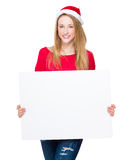 Woman with christmas hat and hold blank placard Royalty Free Stock Images