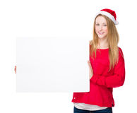 Woman with christmas hat hold with blank white board Stock Image