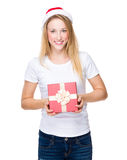 Woman with christmas hat and hold with gift box Stock Image