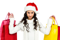 Woman with christmas hat holding colored shopping bags Stock Photos