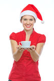 Woman in Christmas hat holding cup of hot beverage Stock Photos