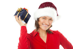 Woman with christmas hat holding a present Stock Photo