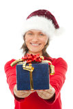 Woman with christmas hat holding a present Royalty Free Stock Photography