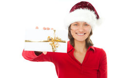 Woman with christmas hat holding present on white Royalty Free Stock Images