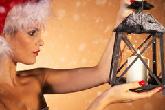 Woman with christmas hat and lantern Stock Photography