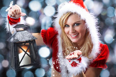 Woman with christmas hat and lantern Royalty Free Stock Image