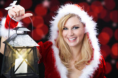 Woman with christmas hat and lantern Royalty Free Stock Images
