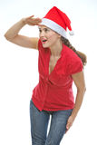 Woman in Christmas hat looking into distance Royalty Free Stock Images