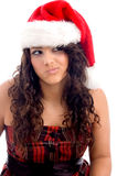 Woman with christmas hat making face Stock Photos