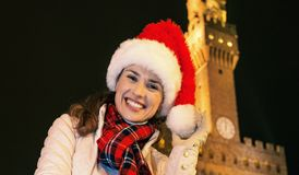 Woman in Christmas hat near Palazzo Vecchio in Florence, Italy Stock Images