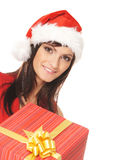 A woman in a Christmas hat opening a present Stock Photo