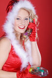 Woman on Christmas hat and phone Stock Photography