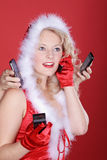 Woman on Christmas hat and phone Stock Photos