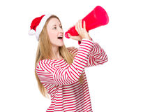 Woman with christmas hat and shout with megaphone Stock Photography