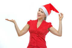 Woman in Christmas hat showing something on palm Stock Photo