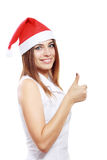 Woman in Christmas hat smiling Stock Photo
