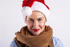 Woman in christmas hat smiling over white background. Stock Image