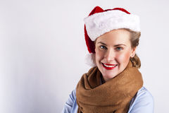 Woman in christmas hat smiling over white background. Stock Photography