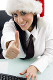 Woman with christmas hat and thumbs up Royalty Free Stock Photography