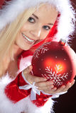 Woman with Christmas hat and xmas ball Royalty Free Stock Photo
