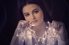 Woman with Christmas light garland Royalty Free Stock Photo