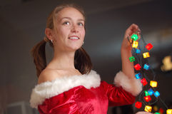 Woman with Christmas lights Stock Photography