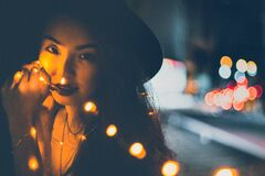 Woman with Christmas lights Royalty Free Stock Image