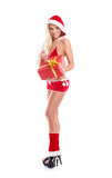 A woman in Christmas lingerie holding a present Royalty Free Stock Photos