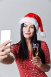 Woman in Christmas makes selfie royalty free stock photography
