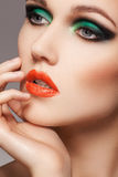 Woman with christmas makeup. Close-up beautiful model face with fashion make-up Royalty Free Stock Photography