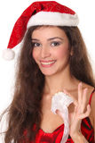 Woman with Christmas or New Year decoration. Woman in red Santa hat with Christmas or New Year decoration Royalty Free Stock Photography
