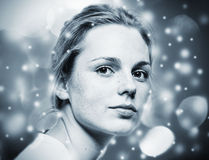 Woman Christmas  New Year portrait,  lights snow and black and white background Stock Photo