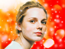 Woman Christmas  New Year portrait,  lights snow and red background Royalty Free Stock Photography