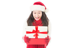 Woman Christmas opening gift surprised and happy Royalty Free Stock Image
