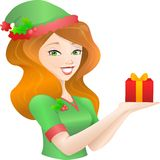 Woman in Christmas Outfit Holding a Gift Box. Royalty Free Stock Image