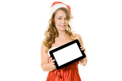 Woman in christmas outfit holding tablet computer Stock Images