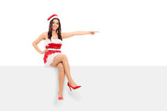 Woman in a Christmas outfit pointing right Stock Photos