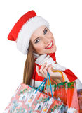 Woman in Christmas outfit with shopping bags Royalty Free Stock Photography