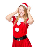 Woman with christmas party dress and adjust her hat Royalty Free Stock Photos
