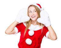 Woman with christmas party dress and listen something Stock Image